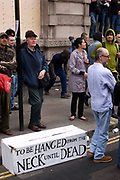 "Protesters gather to deomontstrate against various issues outside the Bank of England in the heart of the City of London. Issues such as anti climate change, capitalism and those against the credit crisis were the main points of the day. Bankers being a particular target of protest. A sign using the old phrase as used by a judge ""To be hanged from the neck until dead"" references the bankers and banking industry."