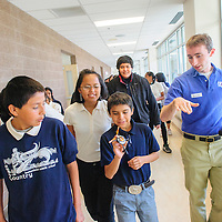 050714       Adron Gardner<br /> <br /> Seventh-grade student Trey Duncan, center, holds a quadcopter robot as Daniel Frank, right, describes flight of the robot at Tsehootsooi Middle School in Fort Defiance Wednesday.