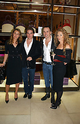 Left to right, TANA RAMSAY, KEVIN ZEGERS, DAVID FURNISH and KELLY HOPPEN at a Christmas party to celebrate the 225th Anniversary of Asprey held at their store 167 New Bond Street, London on 7th December 2006.<br />