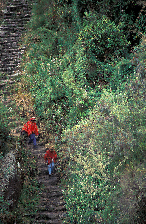 Huilloc villagers in their red costume on the Inca Trail, Cuzco, Peru