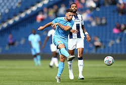 """Coventry City's Tony Andreu attempts a shot on goal during the Cyrille Regis Memorial Trophy match at The Hawthorns, West Bromwich. PRESS ASSOCIATION Photo. Picture date: Saturday July 28, 2018. See PA story SOCCER West Brom. Photo credit should read: Barrington Coombs/PA Wire. RESTRICTIONS: EDITORIAL USE ONLY No use with unauthorised audio, video, data, fixture lists, club/league logos or """"live"""" services. Online in-match use limited to 75 images, no video emulation. No use in betting, games or single club/league/player publications."""