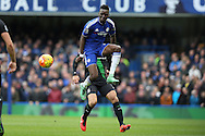 Bertrand Traore of Chelsea jumps to pass the ball. Barclays Premier league match, Chelsea v Stoke city at Stamford Bridge in London on Saturday 5th March 2016.<br /> pic by John Patrick Fletcher, Andrew Orchard sports photography.