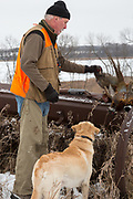 Cecil Bell hunts late-season pheasants in Minnesota with his rescued yellow Lab-mix, Bric. Cecil Bell and his rescued Lab mix Bric