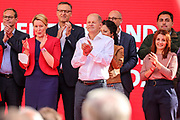 SPD Chancellor candidate and current German Finance Minister Olaf Scholz stands on stage with other members of his Party, during an election campaign event of the German Social Democratic Party (SPD) at Bebelplatz square In Berlin, Germany, August 27, 2021. Germany's federal elections are due to take place on September 26, 2021.