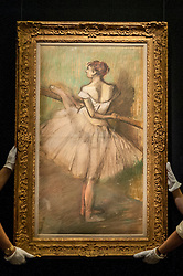 """© Licensed to London News Pictures. 19/06/2015. London, UK. Sotheby's staff show Edgar Degas' """"Danseuse à la barre"""", (est. £1.0m-£1.5m) at Sotheby's Impressionist, Modern & Contemporary Art preview, ahead of the sale on 24 June 2015. Leading the sale are Kazimir Malevich's, """"Suprematism, 18th Construction"""" and Edouard Manet's """"Le Bar aux Folies-Bergère"""".  Photo credit : Stephen Chung/LNP"""