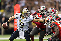 NEW ORLEANS, LA - SEPTEMBER 20:  Drew Brees #9 of the New Orleans Saints tries to avoid the rush from Clinton McDonald #98 and Gerald McCoy #93 of the Tampa Bay Buccaneers at Mercedes-Benz Superdome on September 20, 2015 in New Orleans Louisiana.  The Buccaneers defeated the Saints 26-19.  (Photo by Wesley Hitt/Getty Images) *** Local Caption *** Drew Brees; Gerald McCoy; Clinton McDonald