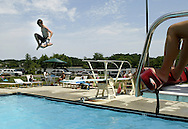 Nick Seril, 15, takes a big leap off the Sport Core Pool diving board in Ocean Pines on Saturday afternoon..