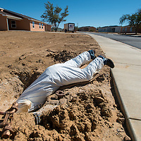 101513       Brian Leddy<br /> Navajo Tribal Utility Authority employee Milfrod Tahe installs a water meter at home in Crownpoint Tuesday.