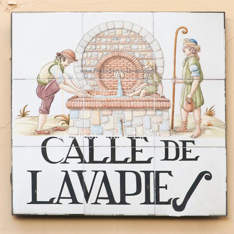 Ceramic street sign in Madrid, Spain Calle de Lavapies - feet washing street