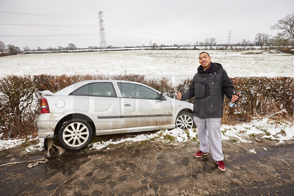 © Licensed to London News Pictures.  03/02/2015. AYLESBURY, UK. Theo Call, 21, pictured next to his crashed car. Theo, who has been driving for a just over a year, skidded going round a corner despite only going 5 miles an hour and ended up stuck in a ditch. <br /> <br /> Thames Valley Police have closed Bishopstone Road near Aylesbury after deeming it too dangerous following a series of accidents and stuck vehicles. Overnight over an inch of snow fell and is causing travel chaos across the region. Photo credit: Cliff Hide/LNP