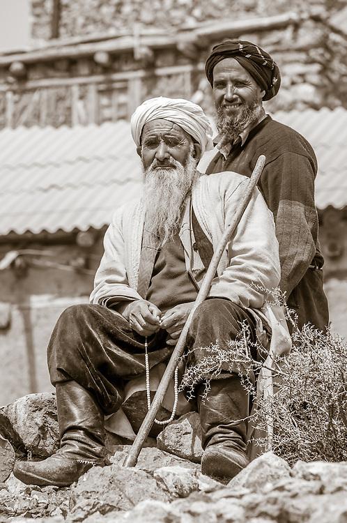 Portrait of father and son farmers in western Tajikistan