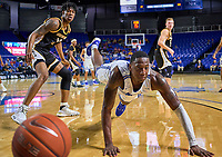 Middle Tennessee Blue Raiders forward Reggie Scurry (22) dives after the ball during the Southern Mississippi Golden Eagles at Middle Tennessee Blue Raiders college basketball game in Murfreesboro, Tennessee, Saturday, March, 7, 2020.<br /> Photo: Harrison McClary/All Tenn Sports