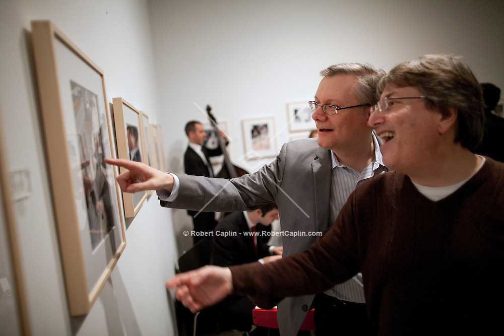 """David Letterman's staff holiday party was also a photo gallery exhibition by his staff writer Steve Young (left) entitled """"CELEBRIGUM"""" held at Ameringer McEnery Yohe Gallery  in New York. ..Photo by Robert Caplin."""