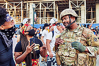 Black Lives Matter protesting the death of George Floyd march from Midtown Atlanta to Centennial Park.  Protestors interact with the Georgia National Guard at Centennial Park.