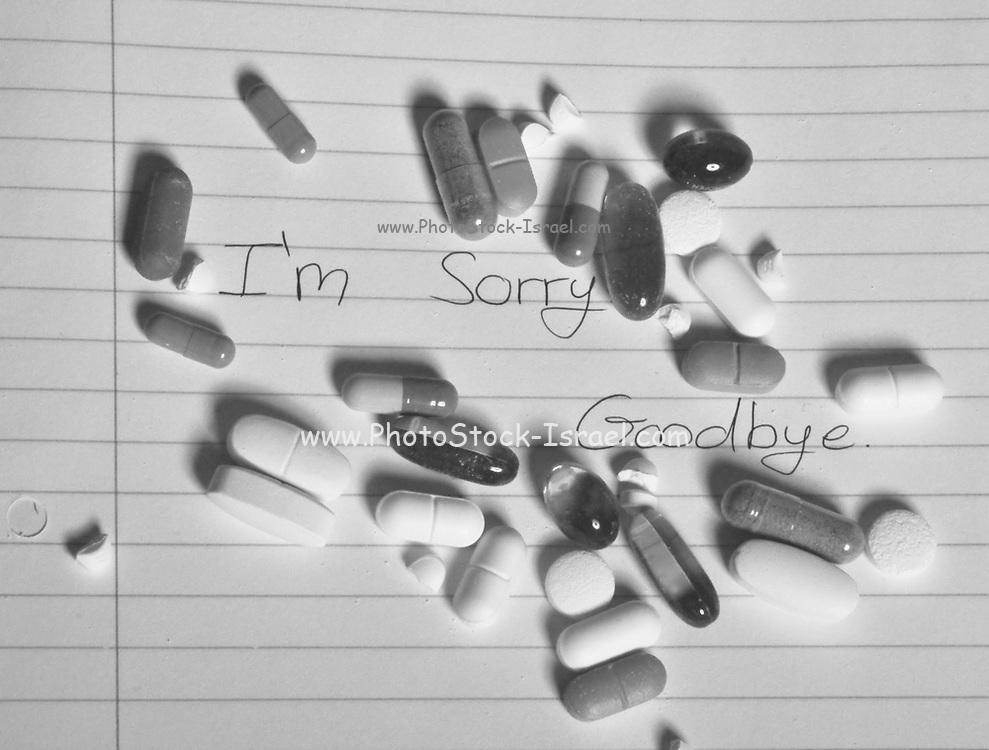 Teenage suicide - pills and medicine on a suicide note