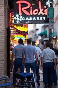 19 SEPTEMBER 2006 - NEW ORLEANS, LOUISIANA: Tourists walk past a strip club on Bourbon Street in New Orleans. Photo by Jack Kurtz / ZUMA Press
