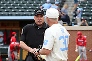 CHAPEL HILL, NC - FEBRUARY 21: Home plate umpire Barry Chambers talks with UNC head coach Mike Fox (30). The University of North Carolina Tar heels hosted the Saint John's University Red Storm on February 21, 2018, at Boshamer Stadium in Chapel Hill, NC in a Division I College Baseball game. St John's won the game 5-2.