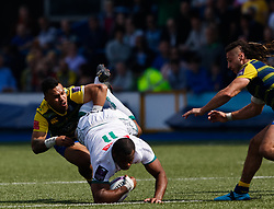 Pau's Watisoni Votu is tackled by Cardiff Blues' Willis Halaholo<br /> <br /> Photographer Simon King/Replay Images<br /> <br /> European Rugby Challenge Cup - Semi Final - Cardiff Blues v Pau - Saturday 21st April 2018 - Cardiff Arms Park - Cardiff<br /> <br /> World Copyright © Replay Images . All rights reserved. info@replayimages.co.uk - http://replayimages.co.uk