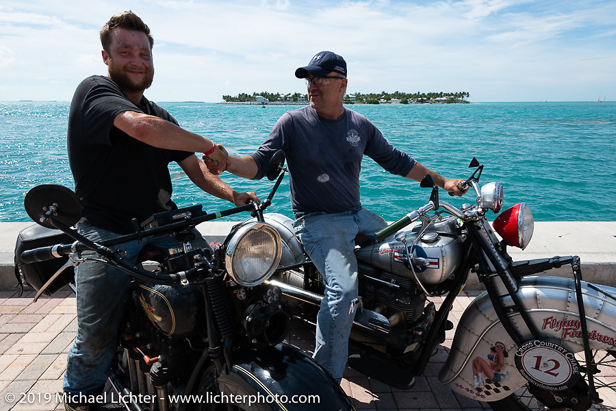 Loring Hill (L) on his 4-cylinder Henderson beside his Dad Mark on his 1940 Indian 4-cylinder after crossing the finish line of the Cross Country Chase motorcycle endurance run from Sault Sainte Marie, MI to Key West, FL. (for vintage bikes from 1930-1948). The Grand Finish in Key West's Mallory Square after the 110 mile Stage-10 ride from Miami to Key West, FL and after covering 2,368 miles of the Cross Country Chase. Sunday, September 15, 2019. Photography ©2019 Michael Lichter.