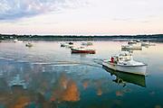 A boat goes through a boy in Addison, Maine.