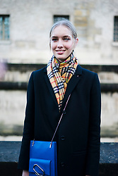 A model, wearing blue coat and Burberry scarf, is seen in the streets of Paris after the Valentino show during Paris Fashion Week Womenswear Fall/Winter 2018/2019 on March 4, 2018 in Paris, France.  (Photo by Nataliya Petrova/NurPhoto/Sipa USA)