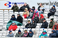 Spectators wrapped up warm against the cold temperatures during the third day of the Specsavers County Champ Div 1 match between Somerset County Cricket Club and Yorkshire County Cricket Club at the Cooper Associates County Ground, Taunton, United Kingdom on 29 April 2018. Picture by Graham Hunt.