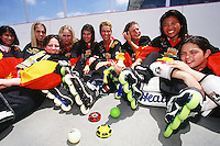 16 June 1998:  Womens Sun Hockey Z roller hockey team crashes together on the ground after playing a roller hockey game in the hot sun. These girls were the RHI-A Womens State Champions in 1998. Transparency slide scan.