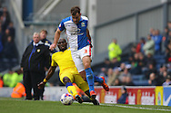 Souleymane Doukara of Leeds United tackles Tommy Spurr of Blackburn Rovers. Skybet football league Championship match, Blackburn Rovers v Leeds United at Ewood Park in Blackburn, Lancs on Saturday 12th March 2016.<br /> pic by Chris Stading, Andrew Orchard sports photography.