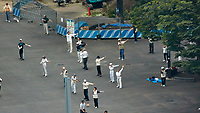 Early Morning Strech and Exercise at Niagara Falls in Shinjuku Chuo Park in Tokyo. Image taken with a Nikon 1 V3 camera and 70-300 mm VR lens from my hotel room on the 20th floor in the Keio Plaza hotel (aprox. 400 meters distance).