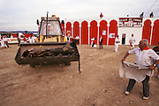 Dead bull exiting the bullring in a front-end loader during festival for patron saint festival in Olite, Navarra, Spain.
