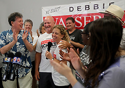 Rep. Debbie Wasserman Schultz (D-Fla.), middle, celebrates with her husband, Steve, in claiming victory as election results come in along with campaign volunteers, local candidates, and elected officials, at her campaign's headquarters in Davie, Fla., on Tuesday, Nov. 6, 2018. Photo by Mike Stocker/Sun Sentinel/TNS/ABACAPRESS.COM