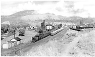 """Looking north in the D&RGW Durango yards while #315 switching the San Juan.  Another engine and crew are waiting, perhaps to take the string of freight cars east.<br /> D&RGW  Durango, CO  Taken by Richardson, Robert W. - 9/1946<br /> In book """"Durango: Always a Railroad Town (1st ed.)"""" page 31"""