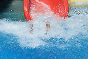 Israel, Sfaim water Park, summer fun on water slides only feet visable