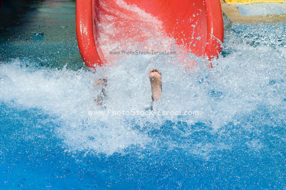 Israel, Sfaim water Park, summer fun on water slides only feet visable
