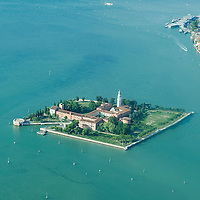 VENICE, ITALY - AUGUST 14:  Aerial views of San Lazzaro on the day  when a solemn Mass is held for the celebration of the Assumption at the Armenian monastery of San Lazzaro on August 14, 2011 in Venice, Italy. The Armenian Monastery is based on San Lazzaro which is a small island in the Venetian Lagoon lying immediately west of the Lido it is completely occupied by the monastery, founded around 1707, is the mother-house of the Mekhitarist Order, the island is one of the world's foremost centers of Armenian culture