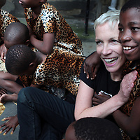Children from the African Children's Choir help Singer Annie Lennox unveil a memorial to Nelson Mandela,the stone bears the inscription of Mr Mandela's Aids Charity 46664 outside Edinburgh's City Chambers.PRESS ASSOCIATION Photo:Photo date:Wednesday 19 August,2009.See PA story.Photo credit should read David Cheskin/PA wire.