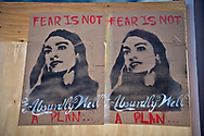 Portrait of Alexandra Ocasio-Cortez wheatpasted in Washington D.C. on boarded up shop. Many windows in the Capitol Hill area in Washington D.C. were boarded up in the days lead up to Biden's inuguration.