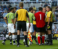 Fotball<br /> England 2005/2006<br /> Foto: SBI/Digitalsport<br /> NORWAY ONLY<br /> <br /> Newcastle United v Deportivo La Coruna<br /> Intertoto Cup.<br /> 03/08/2005.<br /> Tempers flare after a challenge from Newcastle's Alan Shearer (1 from R) leaves the Deportiva goalkeeper, Jose Molina (#1), on the floor.