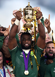 South Africa's Siya Kolisi lifts the Webb Ellis cup after South After win the 2019 Rugby World Cup final match at Yokohama Stadium.