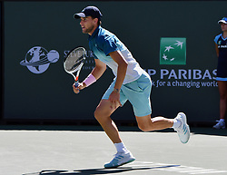 March 16, 2019 - Indian Wells, CA, U.S. - INDIAN WELLS, CA - MARCH 15: Dominic Thiem (AUT) scrambles towards the net in the first set of a semifinals match played during the BNP Paribas Open at the Indian Wells Tennis Garden in Indian Wells, CA.  (Photo by John Cordes/Icon Sportswire) (Credit Image: © John Cordes/Icon SMI via ZUMA Press)