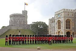 Soldiers from the Coldstream Guards form an honour guard as they await the arrival of US President Donald Trump at Windsor Castle, Windsor.