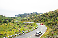 Cyclist riding road into Muir Beach in Golden Gate National Recreation Area. Marin Headlands. San Francisco, CA.