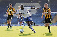 Bury's Jessy Reindorf (c) causes problems for Southend's defenders Mark Phillips and John White after coming on as a substitute. Skybet football league two match, Bury v Southend Utd at Gigg Lane in Bury, England on Sat 21st Sept 2013. pic by David Richards/Andrew Orchard sports photography.