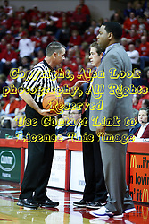 30 January 2011: Referee Kelly Self and Coach Tim Jankovich have a discussion about what constitutes a high elbow foul. Assistant coach Paris Parham looks on during an NCAA basketball game between the Drake Bulldogs and the Illinois State Redbirds. The Redbirds win in OT 77-75 after a last three point shot by Drake was ruled too late at Redbird Arena in Normal Illinois.