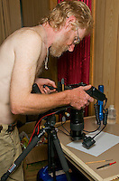 British herpetologist Mark O'Shea photographs a parasitic insect using extreme close-up equipment in his room at the Timor Lodge Hotel in Dili, Timor-Leste (East Timor).