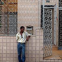 South America, Brazil, Manaus. Adult male waiting outside clinic.