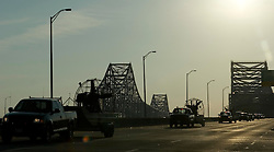 07 Sept 2005. Hurricane Katrina aftermath.<br /> Lines of rescue boats cross the twin span bridge from downtown New Orleans as search and rescue expands to outer lying areas of the city. <br /> Photo; ©Charlie Varley/varleypix.com