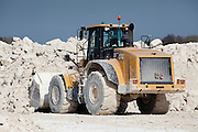 large digger at cement quarry in Bedfordshire picking up a load of chalk