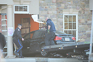 Police personnel remove the vehicle after a woman crashed it into the day care, injuring 4 children, one seriously Thursday, February 27, 2020 at Children of America in Upper Southampton, Pennsylvania. Officials said the vehicle went about 40 feet into the daycare in an area where 17 children were napping.  (Photo by William Thomas Cain)