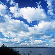 Dramatic white clouds over Penobscot Bay, Northport, Maine.
